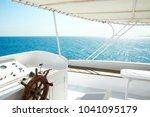 the yacht's steering wheel... | Shutterstock . vector #1041095179