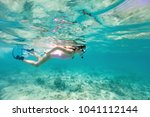 underwater photo of a little...   Shutterstock . vector #1041112144