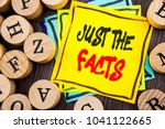 Small photo of Handwriting Announcement text showing Just The Facts. Business photo showcasing Truth Fact Accuracy Honest Concept For Factual Actual written wooden abckground with letters