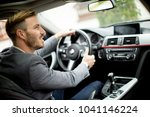young businessman driving in... | Shutterstock . vector #1041146224