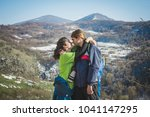 couple of hikers with backpacks ... | Shutterstock . vector #1041147295