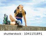 young woman wearing roller...   Shutterstock . vector #1041151891