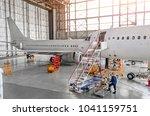 aircraft during repair ... | Shutterstock . vector #1041159751