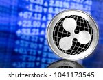 ripple coin on chart background | Shutterstock . vector #1041173545