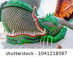 the golden serpent sculpture on ... | Shutterstock . vector #1041218587