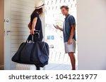 couple using online app to book ... | Shutterstock . vector #1041221977