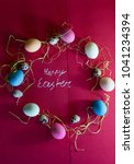 a composition of colorful eggs... | Shutterstock . vector #1041234394