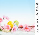 easter eggs on a blue wooden... | Shutterstock . vector #1041250639