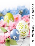 colorful easter eggs and branch ... | Shutterstock . vector #1041250645