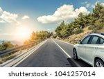 white car rushing along a high... | Shutterstock . vector #1041257014