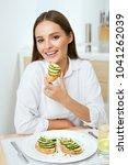 woman eating healthy diet food | Shutterstock . vector #1041262039