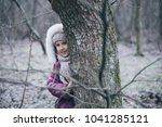 cute little girl in pine forest ... | Shutterstock . vector #1041285121