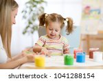 child toddler and mom painting... | Shutterstock . vector #1041288154