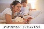 portrait of woman lying in bed... | Shutterstock . vector #1041291721