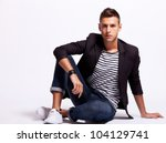 young fashion man looking down... | Shutterstock . vector #104129741