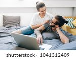 young couple watching a movie... | Shutterstock . vector #1041312409