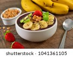 frozen acai bowl with fruits on ... | Shutterstock . vector #1041361105