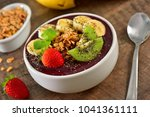frozen acai bowl with fruits on ... | Shutterstock . vector #1041361111