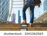 man walking in the city with... | Shutterstock . vector #1041362065