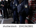police officer guards the... | Shutterstock . vector #1041362881