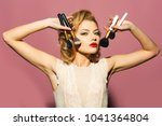 retro woman with makeup brush ...   Shutterstock . vector #1041364804