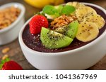 frozen acai berry bowl with... | Shutterstock . vector #1041367969