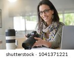 young woman photographer...   Shutterstock . vector #1041371221