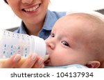 adorable baby drinking a bottle ... | Shutterstock . vector #104137934