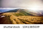 autumn mountains in cloudly day | Shutterstock . vector #1041385039