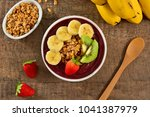 acai berry bowl with sliced... | Shutterstock . vector #1041387979