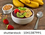 acai berry bowl with sliced... | Shutterstock . vector #1041387991