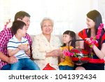 asian three generations family...   Shutterstock . vector #1041392434