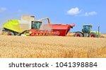 overloading grain harvester... | Shutterstock . vector #1041398884