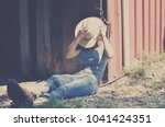 cowgirl in western wear sitting ... | Shutterstock . vector #1041424351