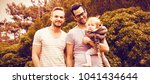 happy gay couple with child in... | Shutterstock . vector #1041434644