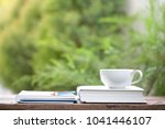 white cup and notebook at... | Shutterstock . vector #1041446107