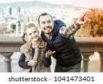 smiling male and small daughter ... | Shutterstock . vector #1041473401