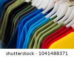 colorful t shirts on hang for...   Shutterstock . vector #1041488371
