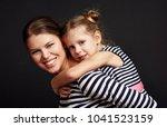 happy smiling mother... | Shutterstock . vector #1041523159