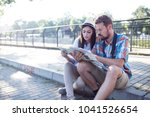 tourist couple traveling and... | Shutterstock . vector #1041526654