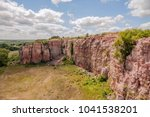 A Wide Angle Landscape of Dramatic Cloudy Summer Sky over a Blue Mounds State Park Cliffside Vista
