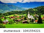 french alps on summer  combloux ... | Shutterstock . vector #1041554221