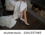 nice legs of the bride in the... | Shutterstock . vector #1041557485