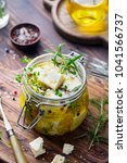feta cheese marinated in olive... | Shutterstock . vector #1041566737