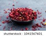 hibiscus tea in black bowl.... | Shutterstock . vector #1041567601