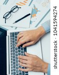 business analyst typing on... | Shutterstock . vector #1041594274