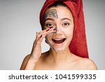 happy woman after shower puts... | Shutterstock . vector #1041599335