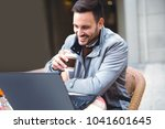 happy man writing text on... | Shutterstock . vector #1041601645