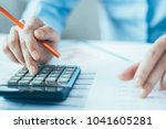close up of manager calculating ... | Shutterstock . vector #1041605281