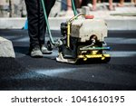 asphalt laying by workers | Shutterstock . vector #1041610195